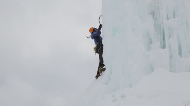 ms tu pan mountain climber digging axe in ice and climbing on ice covered mountain in austrian alps / stubai glacier, tirol, austria  - recreational pursuit stock videos & royalty-free footage