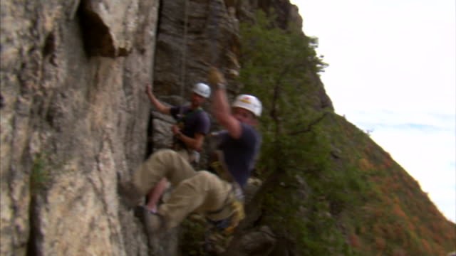 ms pan mountain climber jumping over camera / provo, utah, usa - provo stock videos & royalty-free footage
