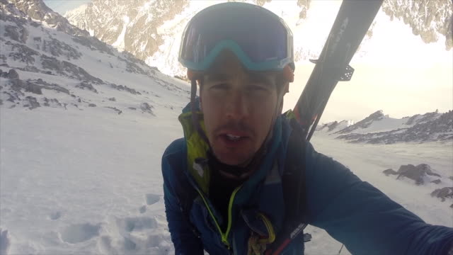 a mountain climber taking a selfie and talking while ice climbing on snow in the mountains. - deep snow stock videos & royalty-free footage