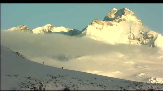 mountain climbers trek across a snowy ridge in patagonia. - snowcapped mountain stock videos & royalty-free footage