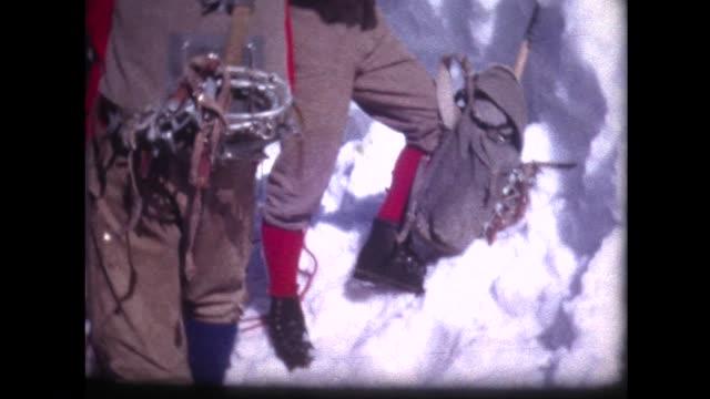 1963 mountain climbers with all their gear - historisch stock-videos und b-roll-filmmaterial