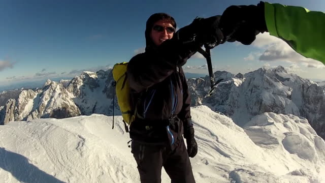 Mountain climbing in the snow using crampons and ice axes. - Model Released - HD