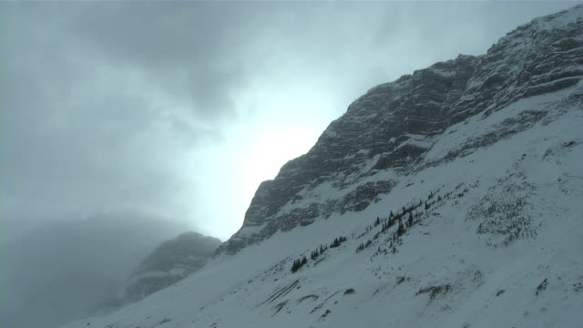 mountain cloud timelapse - snow storm stock videos and b-roll footage