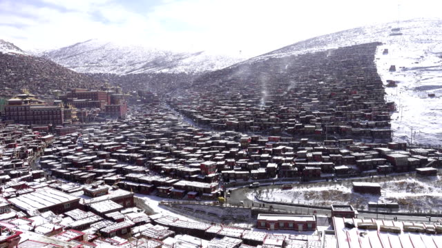 mountain covered with spectacular monks residen in snow, sichuan china - garze tibetan autonomous prefecture stock videos & royalty-free footage