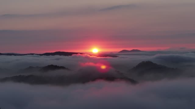 mountain in sea of cloud at dawn - vietnam stock videos & royalty-free footage