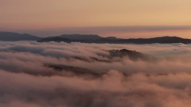 mountain in sea of cloud at dawn - mountain range stock videos & royalty-free footage