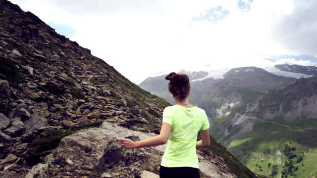 mountain jogging. woman running along mountain trail - mountain pose stock videos and b-roll footage