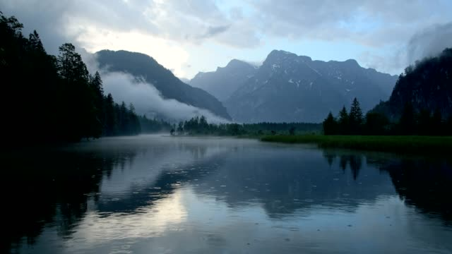 mountain lake at rain in summer, almsee, almtal, upper austria, austria - upper austria stock videos & royalty-free footage