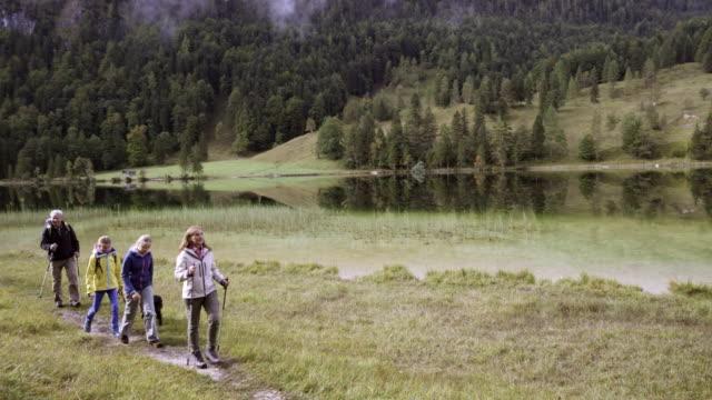 mountain lake, family walking with dog