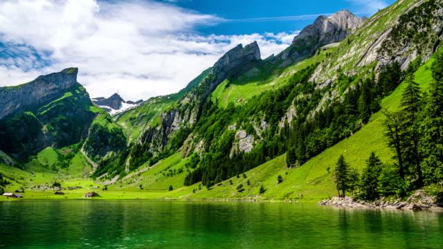 stockvideo's en b-roll-footage met pan: mountain lake - zwitserland