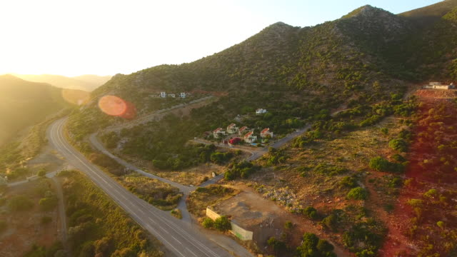 Mountain landscape. Crete, Greece. Road in the mountains. Aerial drone shot.