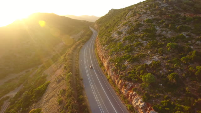 mountain landscape. crete, greece. road in the mountains. aerial drone shot. - mountain road stock videos & royalty-free footage