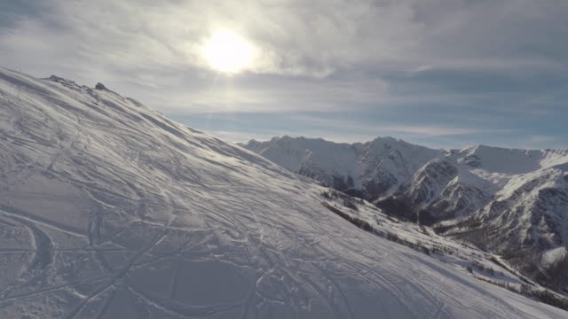 mountain landscape in winter from a chair lift - seggiovia video stock e b–roll