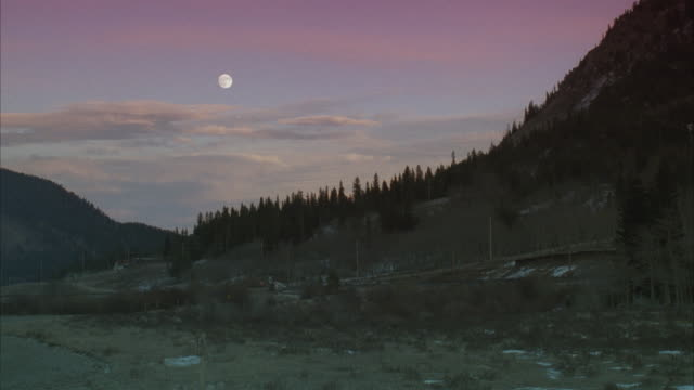 ws, mountain landscape with full moon on moody sky - full moon stock videos & royalty-free footage