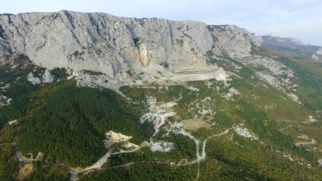 aerial: mountain landscape with granite quarry - granite rock stock videos and b-roll footage