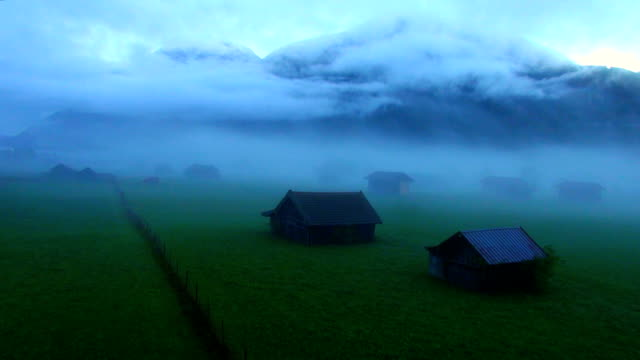 mountain meadow in fog - hut stock videos & royalty-free footage
