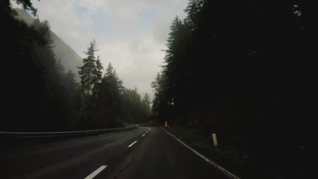 mountain pass and misty winter foggy forest - fog stock videos & royalty-free footage