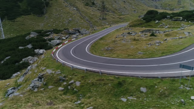 mountain pass with drone. transfagarasan road. - mountain road stock videos & royalty-free footage