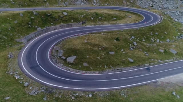 mountain pass with drone. transfagarasan road. - winding road stock videos & royalty-free footage