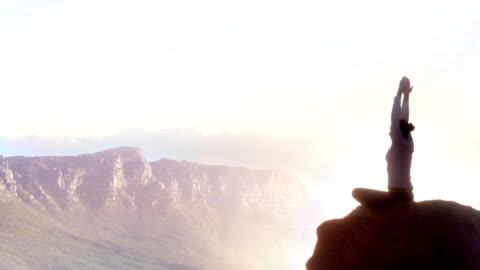 mountain peak meditation woman - meditating stock videos & royalty-free footage