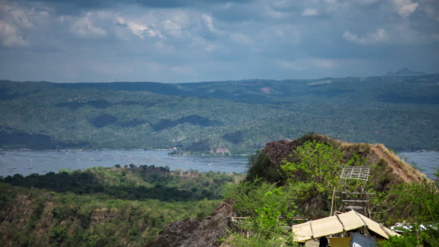 mountain peak overlooking taal lake - time lapse - batangas province stock videos and b-roll footage
