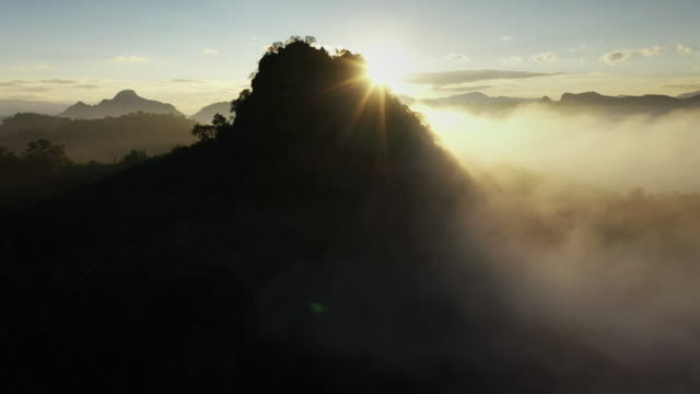 mountain peak with cloud and sunrise, aerial view - named wilderness area stock videos & royalty-free footage