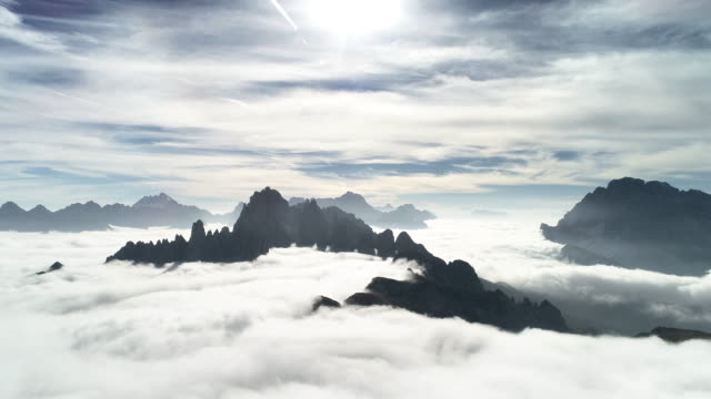 mountain peaks above low level clouds seen from a drones perspective, dolomites, italy - tre cimo di lavaredo stock videos & royalty-free footage