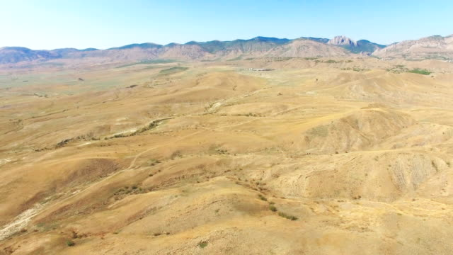 aerial: mountain plateau on background of blue sky - plateau stock videos and b-roll footage