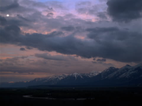 mountain range at sunrise - alm stock-videos und b-roll-filmmaterial