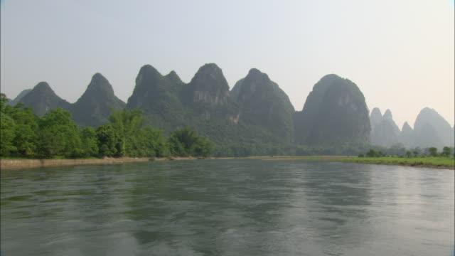 ws pov mountain range by li river, guilin, guangxi zhuang autonomous region, china - guangxi zhuang autonomous region china stock videos & royalty-free footage