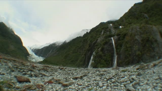WS Mountain range with glacier and waterfall / Franz Josef Glacier, New Zealand