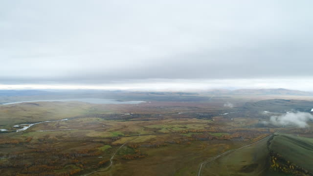 stockvideo's en b-roll-footage met a mountain range with water-irrigation canals. aerial shot, panoramic view. - steppe