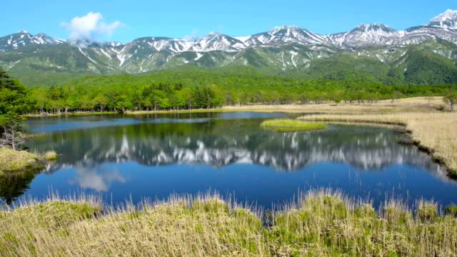 mountain reflection in lake sanko shiretoko, japan - hokkaido stock videos & royalty-free footage