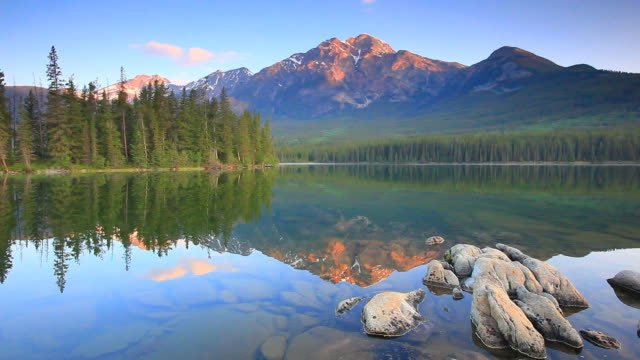 mountain reflection in lake - canada stock videos & royalty-free footage