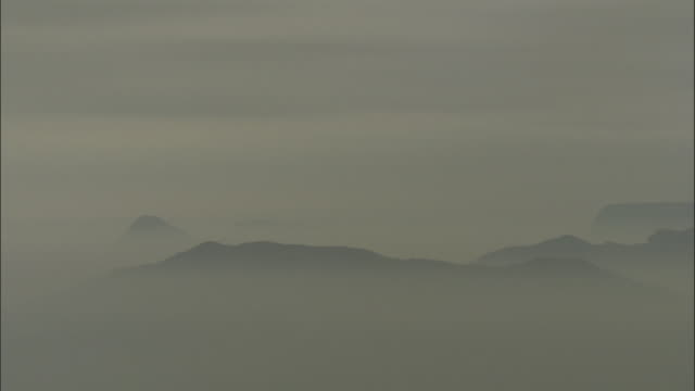 mountain ridges silhouetted in mist, mount emei, china - mountain range stock videos & royalty-free footage