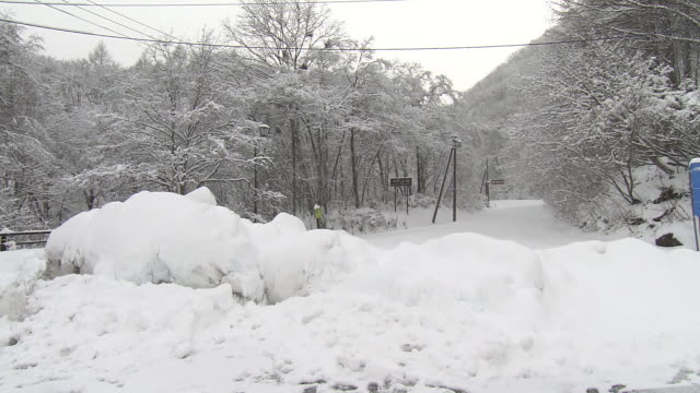 mountain road in heavy snow, fukushima, japan - road closed sign stock videos & royalty-free footage