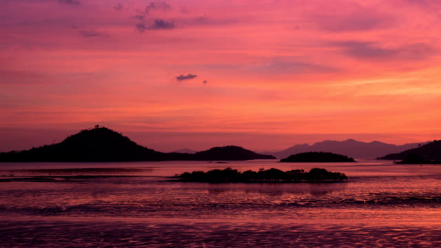 mountain seascape with twilight colorful sky time-lapse