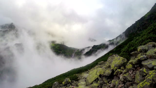 Mountain side in the clouds