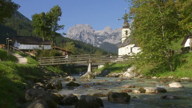 Mountain Stream in Front of Alpine Village (Tilt Down)