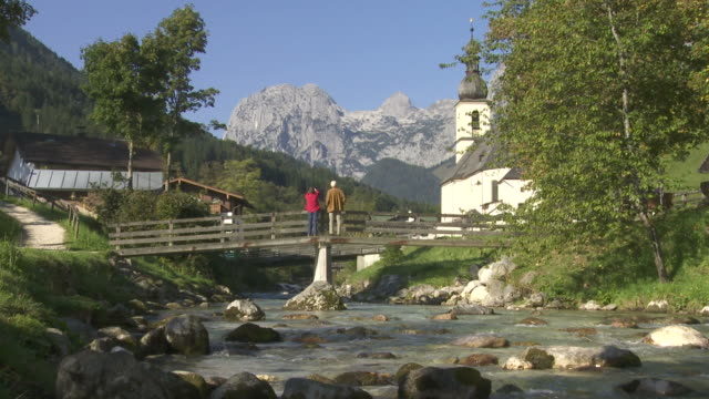 stockvideo's en b-roll-footage met mountain stream in front of village - bavarian alps