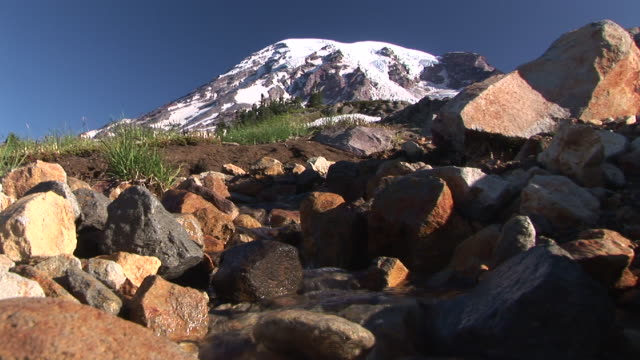 cu, mountain stream with snow capped mount rainier in background, mount rainier national park, washington, usa - mt rainier national park stock videos & royalty-free footage