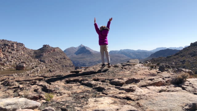 mountain summit arrival girl arms raised success - joy stock videos & royalty-free footage