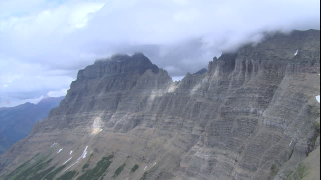 mountain summits with glacier in glacier national park. available in hd. - glacier national park us stock videos and b-roll footage