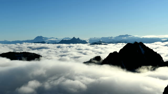 mountain time lapse above the clouds - summit stock videos & royalty-free footage