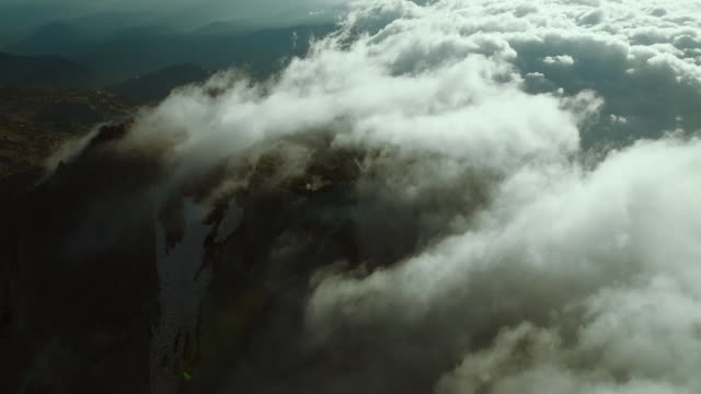 mountain top hidden by clouds - wispy stock videos and b-roll footage