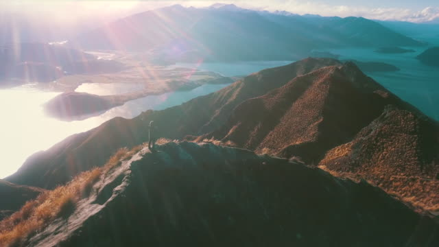 mountain top with mountain climber - landscape scenery stock videos & royalty-free footage