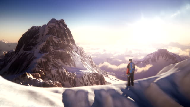 mountain top with mountain climber - snow stock videos & royalty-free footage