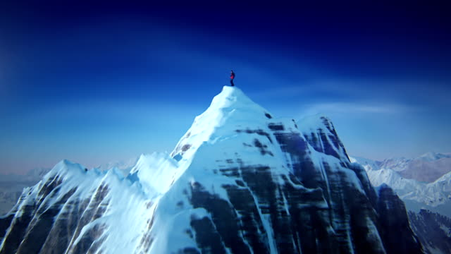 mountain top mit mountain climber - felsklettern stock-videos und b-roll-filmmaterial