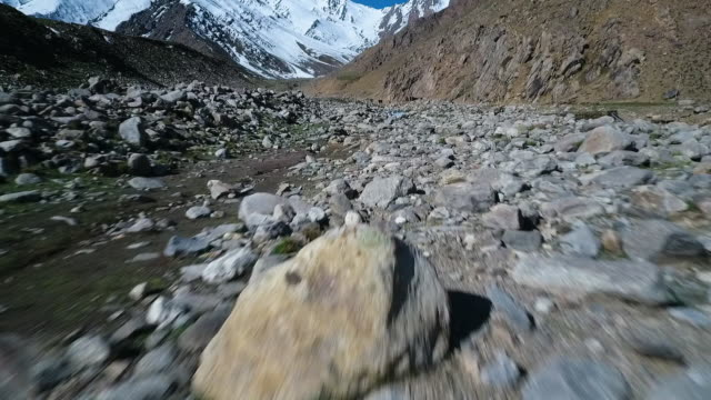 mountain valley covered in stones, rocks across a wide range. - water's edge stock videos & royalty-free footage