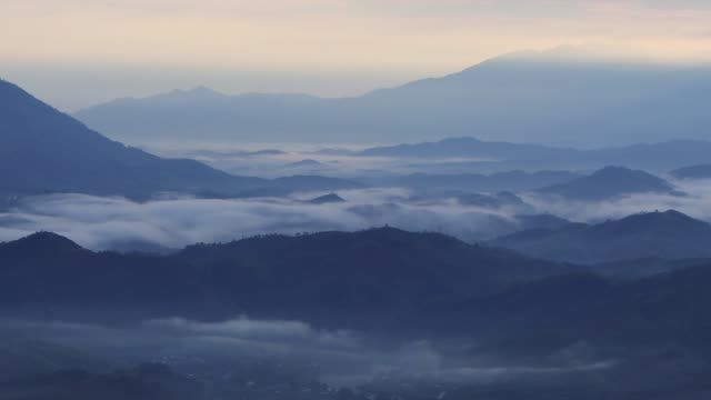 Mountain valley with nice cloud at dawn
